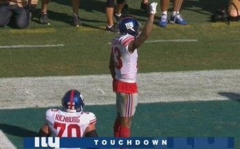 Odell Beckham of the NY Giants Raises His Fist to The Sky to Show Support for the Cause